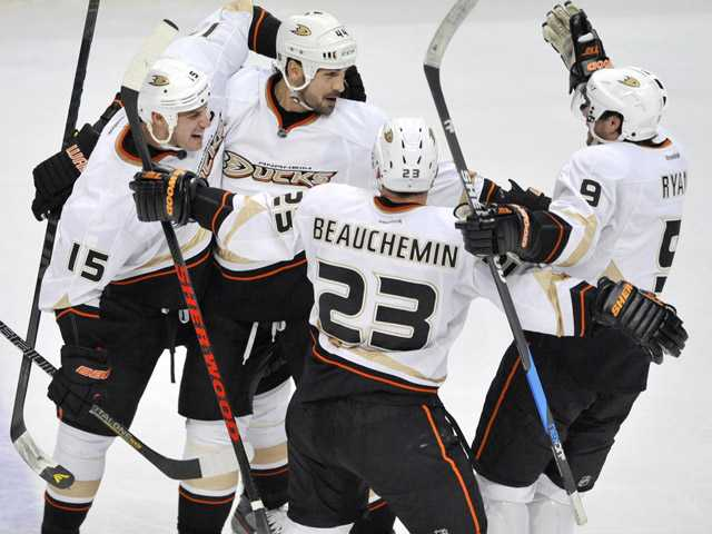 Anaheim Ducks' Sheldon Souray, second from left, celebrates with teammates Ryan Getzlaf, left, Francois Beauchemin, second from right, and Bobby Ryan, right, after scoring against the Chicago Blackhawks in Chicago on Friday. Anaheim won 2-1.