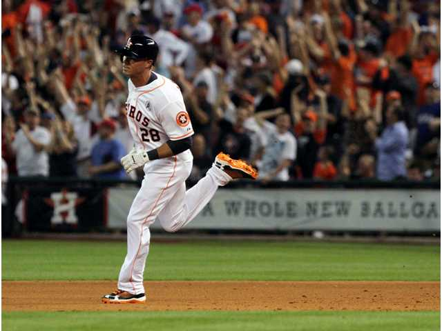 Houston Astros' Rick Ankiel (28) rounds the bases on his three-run home run in the sixth inning on Sunday in Houston.