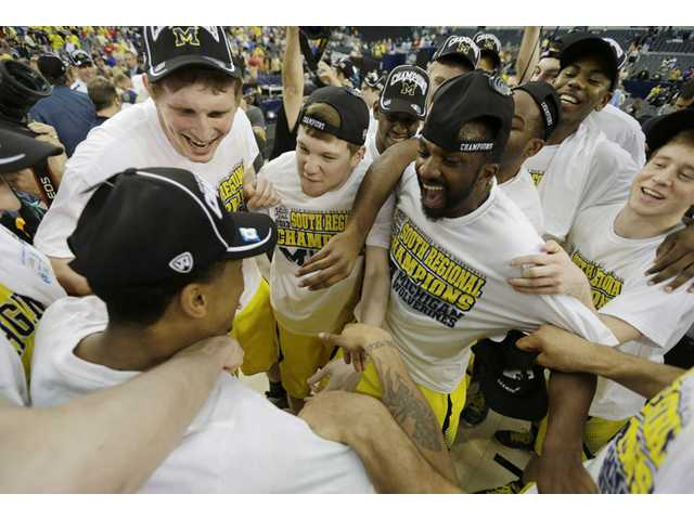 Michigan rolls into Final Four, beats Fla.