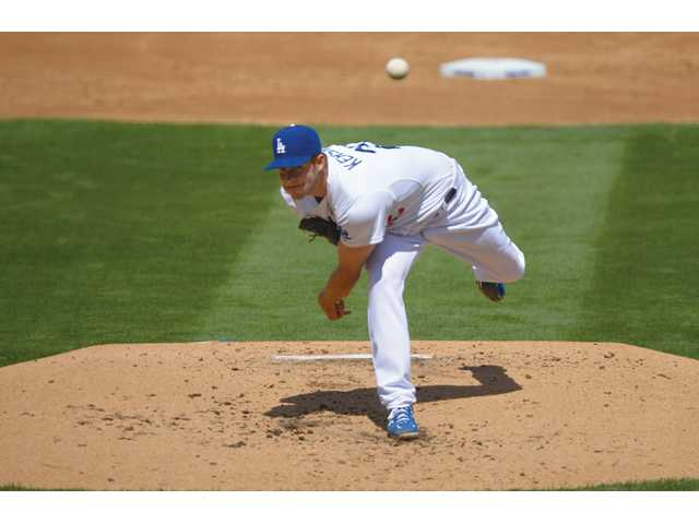 Los Angeles Dodgers starting pitcher Clayton Kershaw throws to the plate against the San Francisco Giants at Dodger Stadium on Monday in Los Angeles.