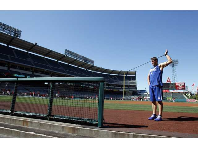 Los Angeles Dodgers pitcher Clayton Kershaw warms up before an exhibition baseball game against the Los Angeles Angels in Anaheim on Saturday.