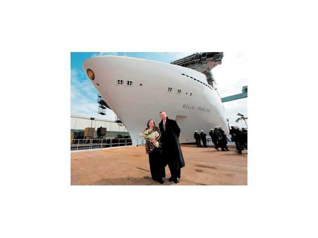 """Regal Princess"" met the water for the first time in a shipyard ceremony Monday featuring ""Madrina"" Carolyn Spencer Brown with Princess Executive Vice President Rai Caluori."