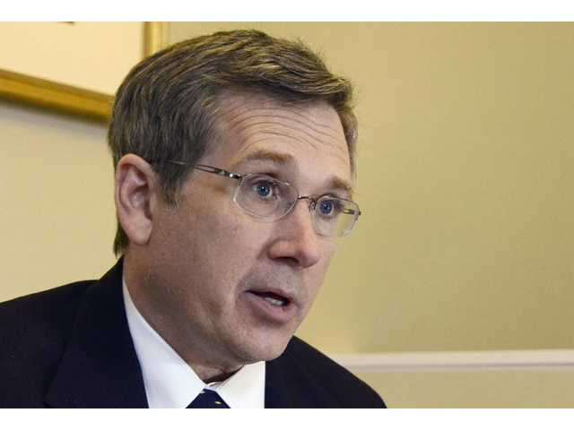 Republican U.S. Sen. Mark Kirk of Illinois speaks at his home in Highland Park, Ill in December 2012.