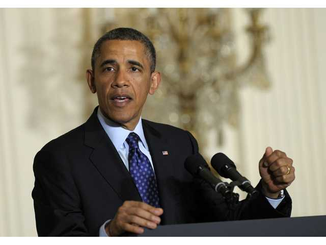 President Barack Obama speaks in the East Room of the White House in Washington on Tuesday.