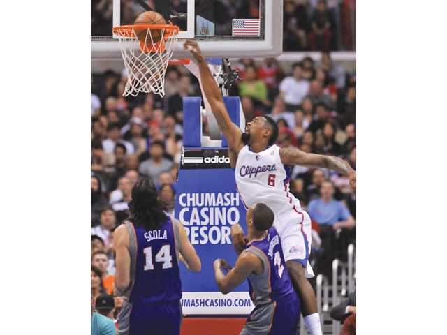 Los Angeles Clippers center DeAndre Jordan (6) throws down a dunk on Wednesday in Los Angeles.
