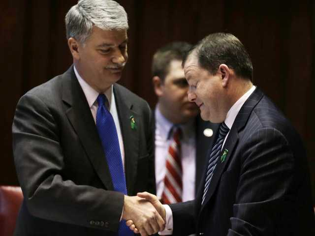 Senate Minority Leader John McKinney, R-Fairfield, who represents Newtown, Conn., right, and Senate President Donald Williams, D-Brooklyn, shake hands after the passage of a gun-control bill in the Senate chamber at the Capitol in Hartford, Conn., on Wednesday.