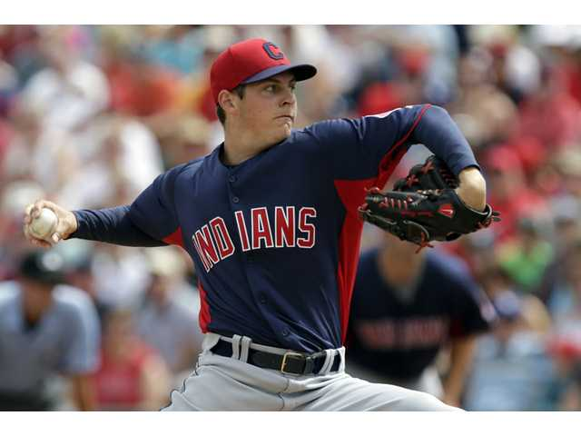 Cleveland Indians starting pitcher and Hart graduate Trevor Bauer throws to the Los Angeles Angels during the first inning of a spring training exhibition baseball game in Tempe, Ariz., on March 20.