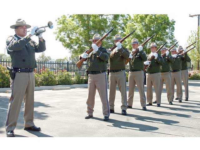 "The California Highway Patrol memorial drill team performs a 21-gun salute during the 2008 memorial and dedication in honor of four CHP officers killed during ""The Newhall Incident"" in 1970. Signal file photo"