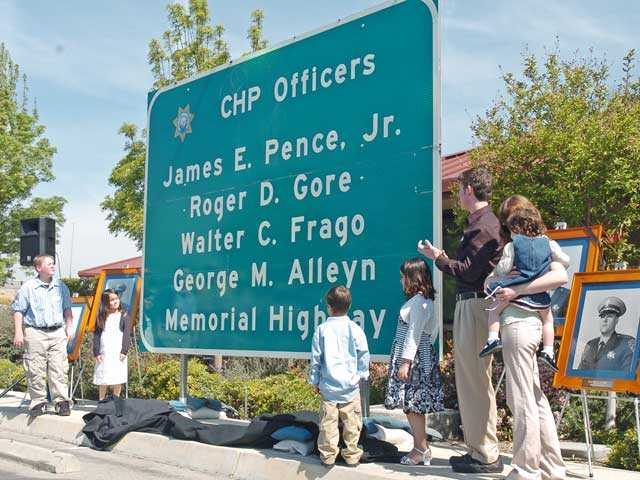 Members of the families of four California Highway Patrol officers killed in the line of duty in 1970 unveil the road sign dedicating a portion of Interstate 5 in the officers' memory. The ceremony was held April 4, 2008. Signal file photo