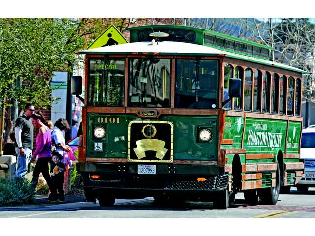 Visitors board the Hometown Trolley, which circled around Main Street during the block party.