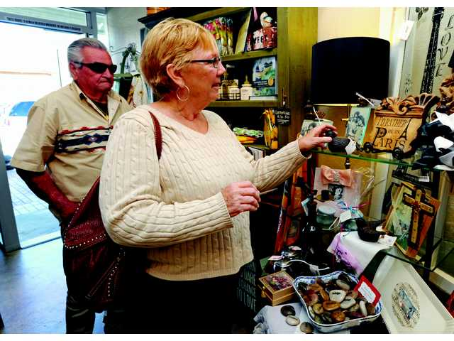 Bob Pierini, left, and Fran Crawford shop at Ma Maison during the block party.