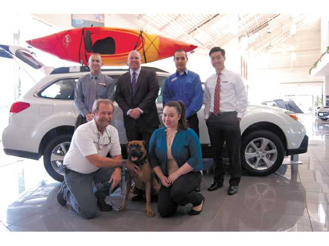 Trainer Mark Tipton and Flex of Angeldogs Foundation, front left and center, with the staff of Galpin Subaru of Valencia (front Andrea Ramos, rear, from left, Will Baxter, David Gillum, Erick Mancera, Jimmy Nguyen). Galpin Subaru is the event's title sponsor.