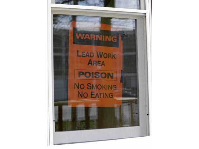 A sign hangs in a window Thursday in Lakewood, Ohio. More than half a million U.S. children are now believed to have lead poisoning, roughly twice the previous high estimate, health officials reported Thursday.