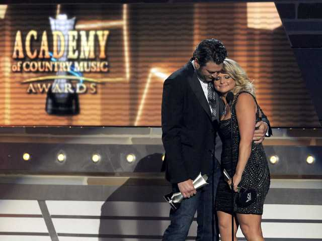 "Miranda Lambert, right, and Blake Shelton accept the award for song of the year for ""Over You"" at the 48th Annual Academy of Country Music Awards."