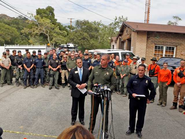 Orange County sheriff's Lt. Jason Park, middle, said Monday that the deputy who was injured in the search for the mmissing hikers last week was upgraded to fair condition.