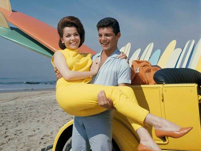 "In this 1963 photo, singer Frankie Avalon and actress Annette Funicello are seen on Malibu Beach during filming of ""Beach Party,"" in California in 1963."