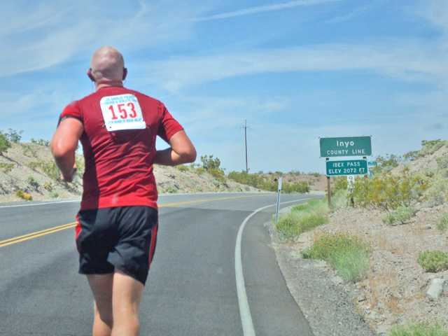 Deputy G. Barlow with the Santa Clarita Valley Sheriff's Station races down the road during 2012 Challenge Cup Baker to Vegas Race. The SCV Sheriff's Station will send a team this Saturday to compete again this year. Photo courtesy of SCV Sheriff's Station