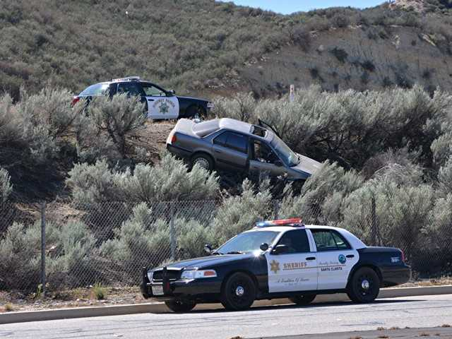 California Highway Patrol officers investigated the scene of a car running off the freeway lanes of the southbound Highway 14 this morning. No one was injured, investigators said. Photo by Rick McClure