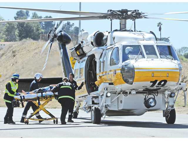 A young boy is airlifted from the scene of a crash on the southbound Highway 14 freeway in Canyon Country on Tuesday that left at least four people injured.