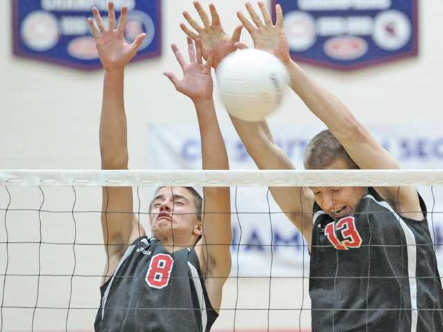 Hart's Adam Marrs (8), left, and Nolyn Preston (13) block a shot by Valencia at Hart on Tuesday.