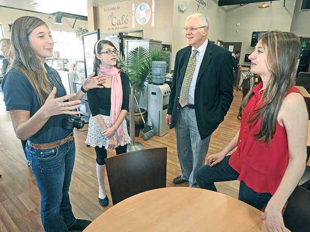 Supervisor Michael D. Antonovich, second right, visits with SCVi charter school student ambassadors, from left, Sydney Hild, 15, Samantha Raskin, 13, and Paige Guarrino, 15, as they chat in the school's new lunchroom during a tour by the supervisor of the Castaic campus today. Signal photo by Dan Watson