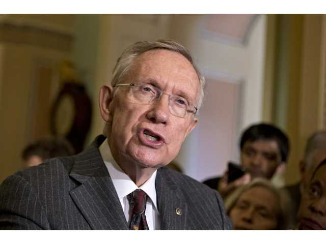 Senate Majority Leader Harry Reid, D-Nev., speaks with reporters following a Democratic strategy session in Washington on Tuesday.