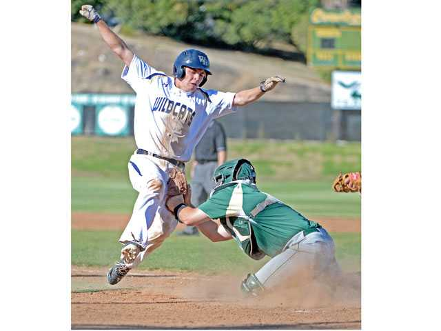 West Ranch's Jake Spurlin, left, is tagged out at home plate by Canyon's Justin Stark on Wednesday at Canyon High.