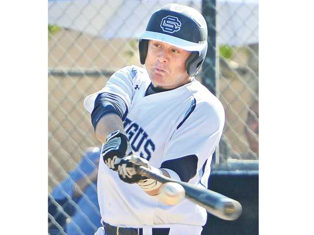 Saugus senior Chris Devery (10) hits a grand-slam against Hart at Saugus High on Wednesday.