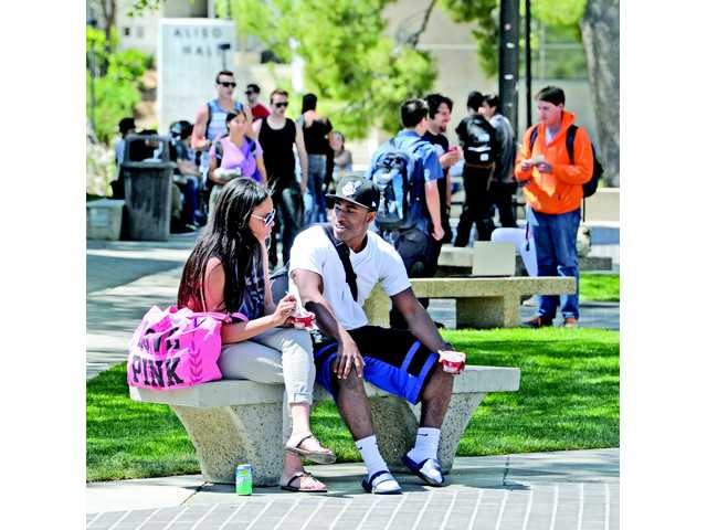 College of the Canyons sophomores Erica Watson, left, and Jon Butler take a break between classes on the Valencia campus Thursday. Signal photo by Dan Watson