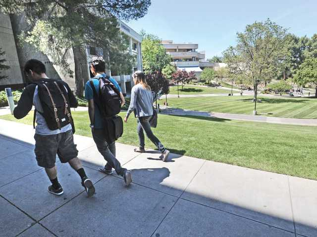 College of the Canyons students head for classes on the Valencia campus Thursday. Signal photo by Dan Watson