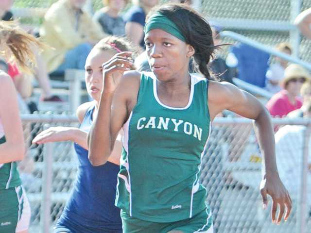 Erica Anunwah of Canyon wins the 100 meter against Saugus at Saugus on Thursday.