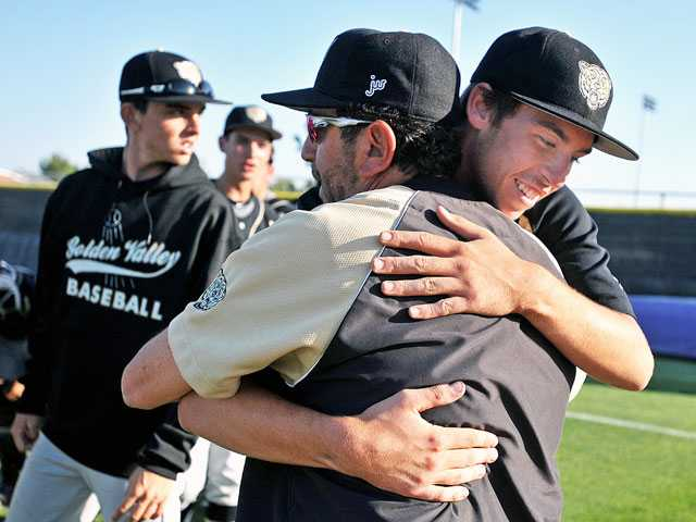 Golden Valley head coach Scott Drootin congratulates pitcher Josh Baldacci after the Grizzlies' 4-2 win over Valencia on Friday at Valencia High School. Baldacci picked up the complete-game victory, allowing just one earned run on seven hits. (Jonathan Pobre/The Signal)