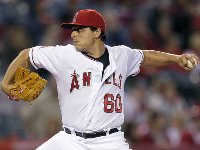 Los Angeles Angels starting pitcher Jason Vargas throws to the Oakland Athletics during the first inning of a baseball game in Anaheim on Thursday.