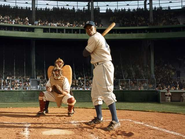 "Chadwick Boseman, right, as Jackie Robinson in Warner Bros. Pictures' release ""42."""