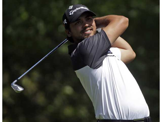 Jason Day, of Australia, tees off on the fourth hole during the second round of the Masters golf tournament Friday in Augusta, Ga.