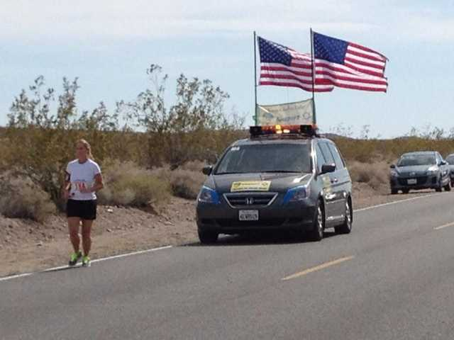 "Deputy C. Hartman running leg 5 for team Santa Clarita Valley station. Every runner is followed by a ""follow vehicle"" throughout the relay race. Photo courtesy of Santa Clarita Valley Sheriff's Station."
