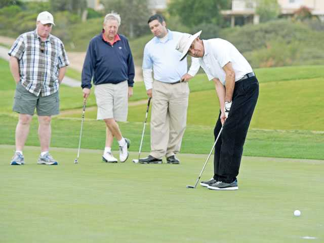 Sheriff joins local residents in fundraising on the links