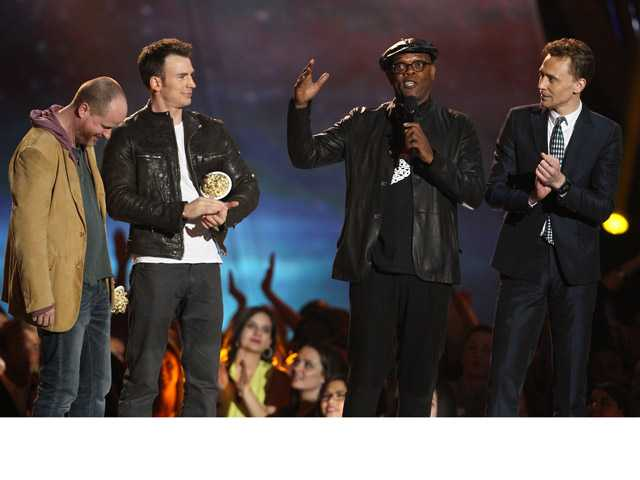 "Joss Whedon, Chris Evans, Samuel L. Jackson and Tom Hiddleston, from left, accept the award for best fight for ""Marvel's The Avengers"" at the MTV Movie Awards in Sony Pictures Studio Lot in Culver City."