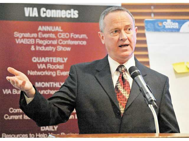 Don Copeland speaks at the Valley Industry Association luncheon on Tuesday.
