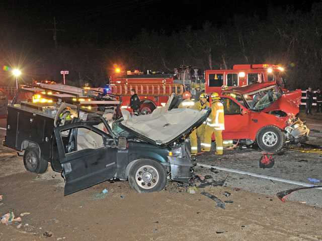 Firefighters work around the wreckage of two pickup trucks that collided on Sierra Highway near Davenport Road in January, killing one driver whose blood alcohol level was reported at .31 percent.