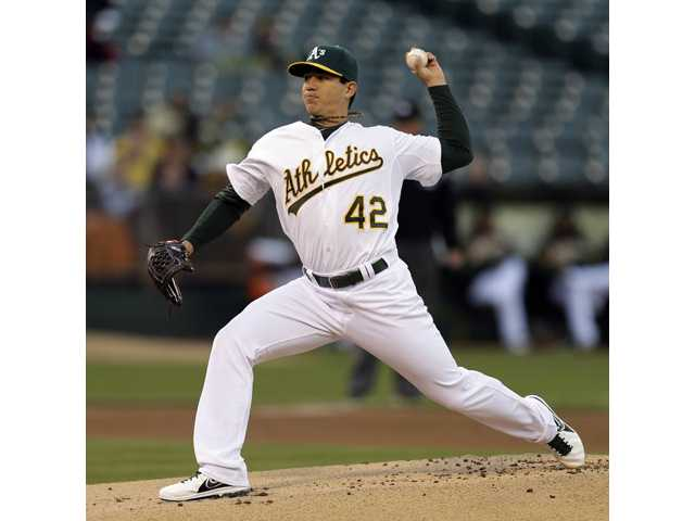 Oakland Athletics pitcher and Saugus High alumnus Tommy Milone works against the Houston Astros on Monday in Oakland.