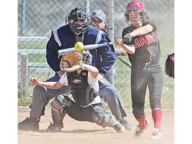 Hart High's Sienna Vannoy (2) hits an RBI double against Golden Valley at Golden Valley on Tuesday. Golden Valley catcher Emily Smith (77)  is behind the plate.  The Indians won 11-0 in six innings.