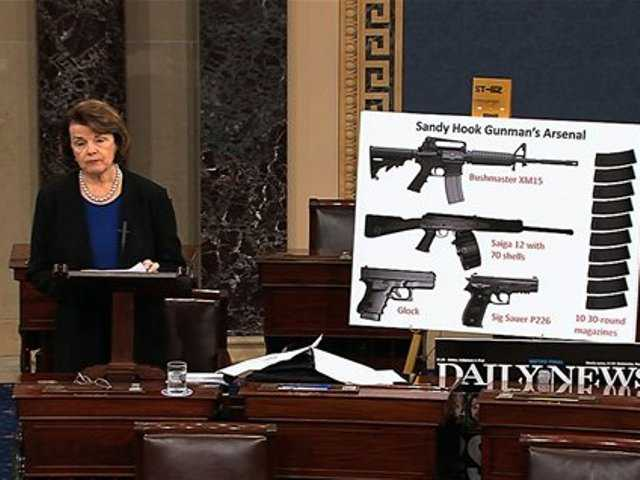 Sen. Dianne Feinstein, D-Calif. using a poster of weapons as she speaks about gun legisalation, Wednesday, April 17, 2013, on the floor of the Senate on Capitol Hill in Washington.
