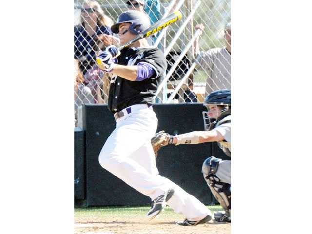 Valencia's Chad Bible hits a two-RBI single against West Ranch on Wednesday at Valencia High School.