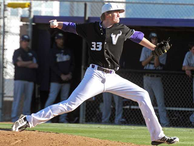 Valencia pitcher J.D. Busfield delivers against West Ranch on Wednesday at Valencia High. The senior pitched a complete-game shutout, allowing three hits and zero walks while striking out seven in Valencia's 6-0 win.