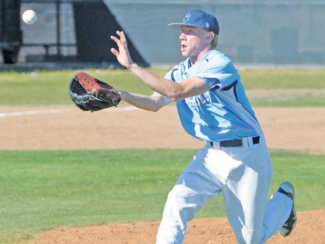 Saugus pitcher Chris Danielson (18) charges on a ground ball in the fourth inning against Golden Valley at Golden Valley High School on Wednesday.