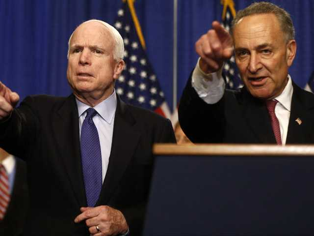 Sen. John McCain, R-Ariz., left, and Sen. Charles Schumer, D-N.Y. take questions during a news conference on immigration reform legislation, Thursday on Capitol Hill in Washington.