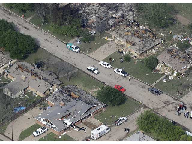 In this Thursday photo, emergency personnel investigate the scene of several homes destroyed by an explosion at the West Fertilzer Co. in West, Texas.