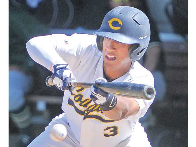College of the Canyons' Ivan Vela (3) lays down a sacrifice bunt on Thursday at COC in the Cougars' 9-2 win.