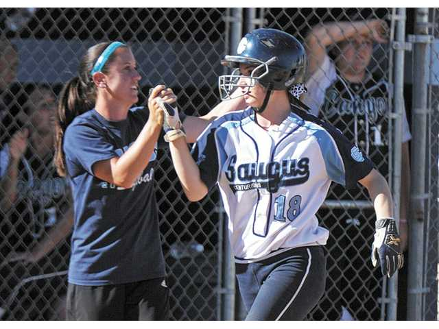 Saugus head coach Julie Watson, left, high-fives Kaela Morrow after she hits a home run against Canyon on Thursday at Saugus High.